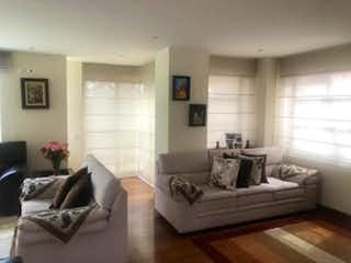 Una sala de estar llena de muebles y una ventana en  Condominio Atalaya
