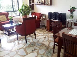 Una sala de estar llena de muebles y una planta en maceta en Apartamento en Nicolas de Federman-Nicolas de Federman - 103mt, tres alcobas, terraza