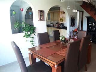 Una sala de estar llena de muebles y una chimenea en Casa En Andalucia - envigado, con dos niveles