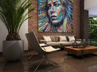 Una sala de estar llena de muebles y una planta en maceta en San Sebastián Aptos