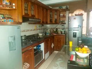 Una cocina con una estufa de nevera y fregadero en No aplica