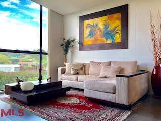 Una sala de estar llena de muebles y una televisión de pantalla plana en Swiss