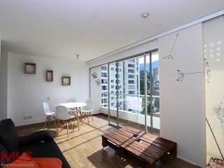 Una sala de estar llena de muebles y una ventana en Manzana Once