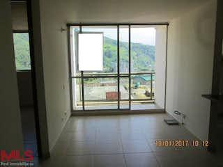 Una vista de una habitación con una puerta corredera de cristal en Colina de Asis