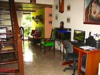 Una sala de estar llena de muebles y una televisión de pantalla plana en Ciudadela Cacique Niquia