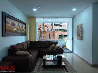 Una sala de estar llena de muebles y una televisión de pantalla plana en Acquavella