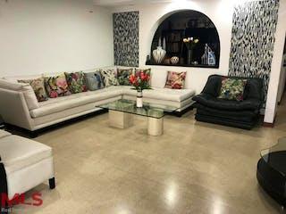 Una sala de estar llena de muebles y una gran ventana en Jardines De La Calera