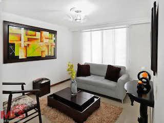 Una sala de estar llena de muebles y una televisión de pantalla plana en Villa Verde 1