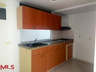 Una cocina con un fregadero y una estufa en San Bartolome