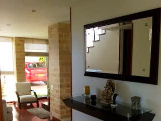 Una sala de estar llena de muebles y una televisión de pantalla plana en  Vivenza Club