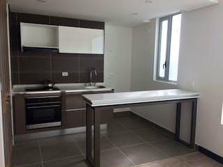 Una cocina con un fregadero y un horno de cocina en Torre Sur Oikos Infinitum