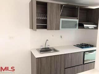 Una cocina con una estufa de fregadero y microondas en Ciudadela Del Valle