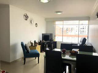 Una sala de estar llena de muebles y una televisión de pantalla plana en Conjunto Prado De Camelias