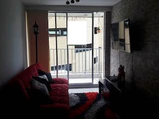 Una sala de estar llena de muebles y una ventana en poblado niquia