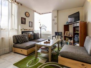 Una sala de estar llena de muebles y una televisión de pantalla plana en Edificio condominio floresta