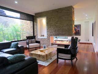 Una sala de estar llena de muebles y una televisión de pantalla plana en Conjunto Parque Residencial Teusaca - lote 46