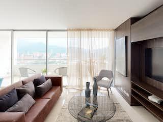 Una sala de estar llena de muebles y una televisión de pantalla plana en Ceiba - Verde Vivo