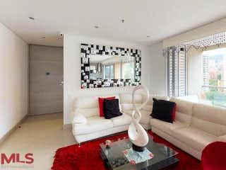Una sala de estar llena de muebles y una gran ventana en Stanza