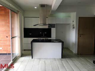 Una cocina con nevera y una estufa en Florida de Norte America