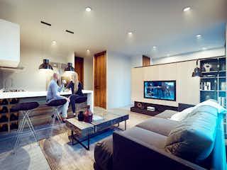 Una sala de estar llena de muebles y una televisión de pantalla plana en Torre Impulsa