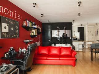 Una sala de estar llena de muebles y una pared roja en Departamento en venta en Acacias de 1 hab. con Gimnasio...