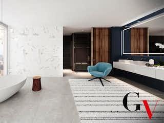 Una bañera sentada al lado de un lavabo de baño en Apartamento en venta en El Retiro de 3 hab. con Piscina...