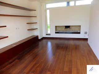Una sala de estar con suelos de madera y suelos de madera en No aplica
