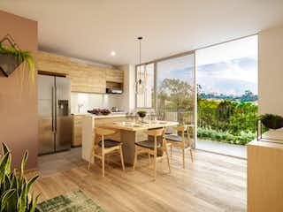 Una cocina con una mesa y sillas en ella en Palma - Verde Vivo
