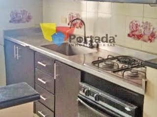 Una cocina con una estufa y un fregadero en No aplica