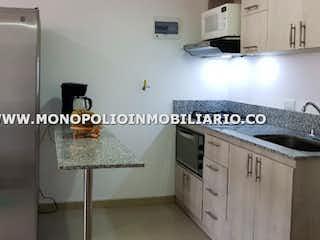 Una cocina con nevera y una estufa en GALES 2803
