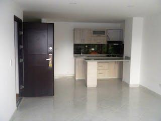 Una cocina con nevera y fregadero en Apartamento en venta en Rosales de 3 hab.